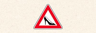 знак женщина за рулем