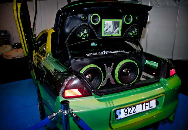 green car with big subwoofer